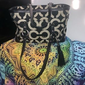 Black and grey fabric/leather lined Coach handbag